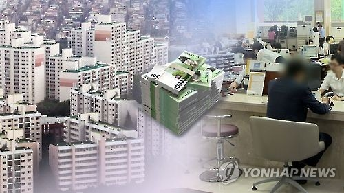 A composite photo of apartments and bank loan service. (Yonhap)