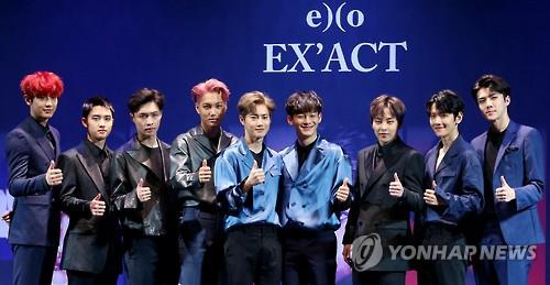 In this file photo, South Korean boy group EXO poses for the camera during a showcase to promote the release of its third album