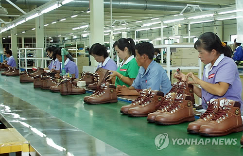 This photo provided by South Korea's unification ministry on Sept. 16, 2013, shows North Koreans working at a factory in the joint industrial complex in North Korea's border city of Kaesong after the operation of the factory zone was resumed after a 166-day suspension. (Yonhap)