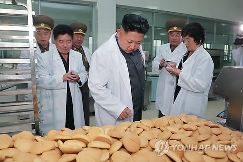 This August 2014 file photo released by the Korean Central News Agency shows North Korean leader Kim Jong-un visiting the November 2 Factory of the Korean People's Army. (For Use Only in the Republic of Korea. No Redistribution) (Yonhap)