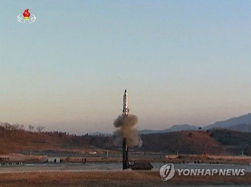 This photo, captured from footage released by North Korea's state-run broadcaster on Feb. 13, 2017, shows the country's latest launch of a new intermediate-range ballistic missile. (Yonhap)