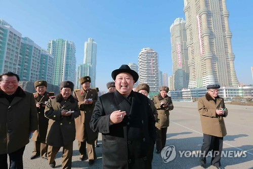 "Accompanied by officials, North Korean leader Kim Jong-un tours the construction site of a newly developed district in Pyongyang, named ""Ryomyong Street,"" in this photo provided by the North's ruling party organ Rodong Sinmun on Jan. 26, 2017. (For Use Only in the Republic of Korea. No Redistribution) (Yonhap)"