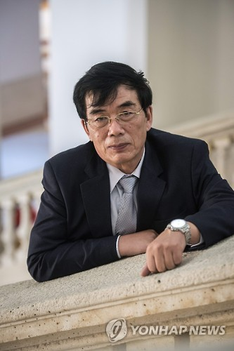 This photo released by Europe's news photo agency EPA on Nov. 8, 2016, shows Lee Gie-myung, chairman of the North Korean Writers in Exile PEN Center. (Yonhap)