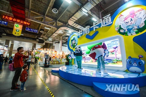 Visitors look at exhibits for the 2016 China International Cartoon and Animation Festival in this file photo from China's state-run news agency Xinhua.
