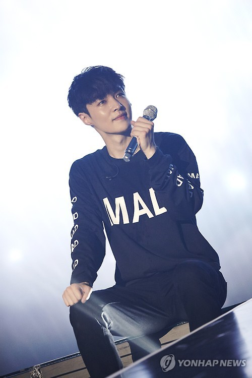 "In his photo provided by S.M. Entertainment, K-pop boy band EXO's Lay performs during the ""EXO PLANET #3 The EXO'rDIUM"" in Seoul on July 24, 2016. (Yonhap)"