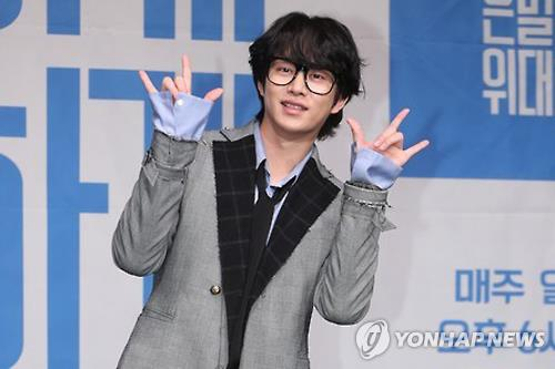"In this file photo, South Korean singer Kim Hee-chul, who stars in ""Secretly Greatly,"" poses for a photo during a publicity event in Seoul on Nov. 30, 2016. (Yonhap)"