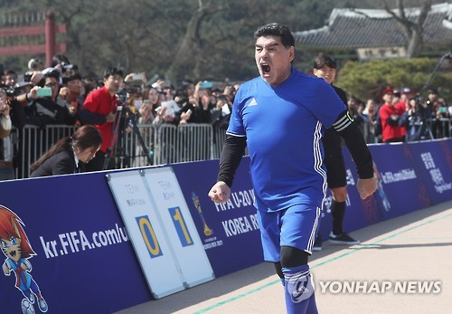 Diego Maradona recreates 'Hand of God' goal in friendly with schoolkids