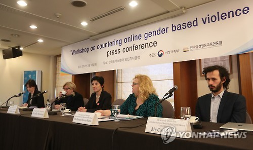 A group of European experts, including Joelle Hivonnet (C), deputy head at the E.U. Delegation in Seoul, speak to reporters at a press conference in northern Seoul on March 14, 2017, on the rising phenomenon of online gender-based violence. (Yonhap)