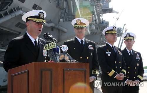 U.S. carrier joins South Korea drills, North Korea warns of 'merciless' strikes