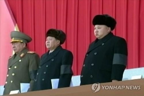 This photo released by North Korea's state media on Dec. 17, 2014, shows North Korean leader Kim Jong-un (R), Choe Ryong-hae (C), a vice chairman of the central committee of the ruling Workers' Party of Korea, and Hwang Pyong-so (L), director of the general political bureau of the Korean People's Army. (For Use Only in the Republic of Korea. No Redistribution) (Yonhap)