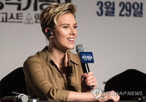 "American actress Scarlett Johansson speaks to reporters during a press conference for her new film ""Ghost in the Shell"" at the Grand InterContinental Hotel in southern Seoul on March 17, 2017. (Yonhap)"