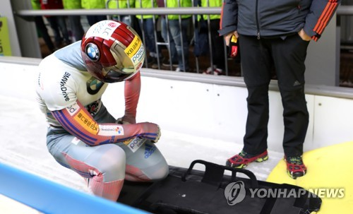 South Korea's Yun Sung-bin reacts after finishing in second place by 0.01 second in the men's skeleton race at the International Bobsleigh and Skeleton Federation World Cup at Alpensia Sliding Centre in PyeongChang, Gangwon Province, on March 17, 2017. (Yonhap)