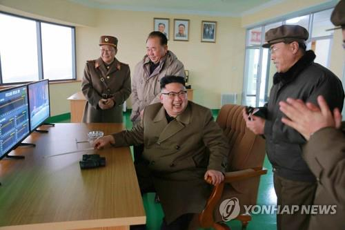 This photo, aired on Chosun Central TV, shows North Korean leader Kim Jong-un (C) flanked by officials at the Sohae Satellite Launching Ground on March 18, 2017. (For Use Only in the Republic of Korea. No Redistribution) (Yonhap)