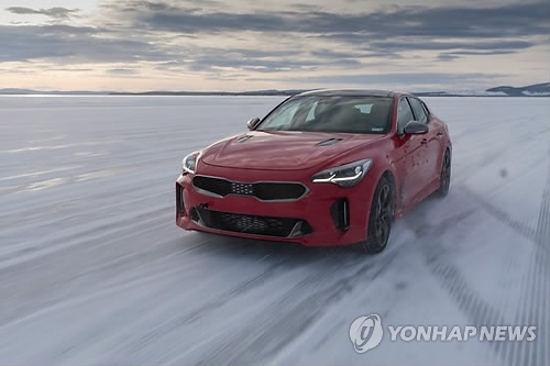 In this photo taken on Feb. 22, 2017, and provided by Kia Motors Corp., the Stinger sports sedan is running on an icy road of a rural county in Sweden as part of cold-weather testing. (Yonhap)