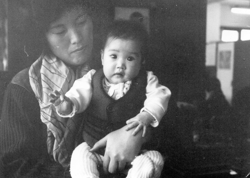 This undated photo, provided by Sara Hultqvist, shows her as a baby in South Korea. The identity of the woman is unknown. (Yonhap)