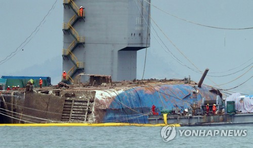 South Korea starts raising ferry that sank in 2014, killing 304 people