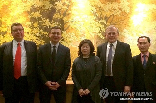 North Korea's deputy nuclear negotiator Choe Son-hui (C) poses with Vladimir Putin's non-proliferation adviser Anton Khlopkov (2nd from L) during a meeting in Pyongyang on March 15, 2017. (Yonhap)