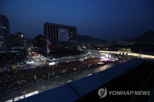 Opponents of ousted President Park Geun-hye stage a massive rally in central Seoul