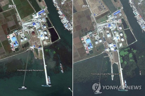 These satellite photos provided by Google Earth show an expansion of oil import capacity at the North Korean port city of Nampo from Oct. 4, 2015, (L) to Oct. 4, 2016. Radio Free Asia reported on March 26, 2017, that North Korea has added a second pier to the port. (Yonhap)