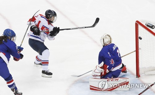 Jong Su-hyon of North Korea scores past Nicole Jackson of Britain during their game at the International Ice Hockey Federation Women's World Championship Division II Group A at Gangneung Hockey Centre in Gangneung Gangwon Province on April