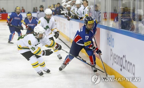 Han Soo-jin of South Korea battles Katherine Mc Onie of Australia at the International Ice Hockey Federation Women's World Championship Division II Group A at Kwandong Hockey Centre in Gangneung Gangwon Province
