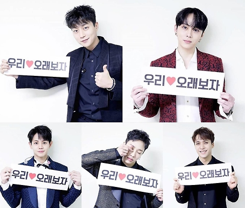 This composite photo captured from Highlight members' social media show team members thanking BEAST fans and asking for their continued support. (Yonhap)