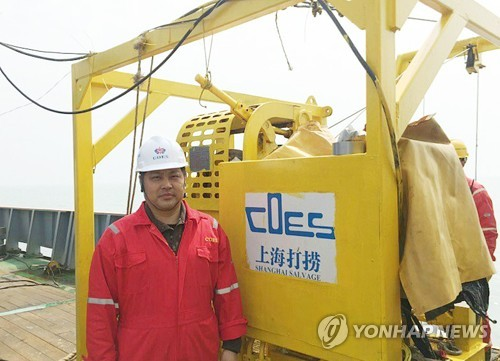 This file photo, provided by Shanghai Salvage, shows Jin Feng, the head of the company's diving unit, on April 9, 2017. (Yonhap)