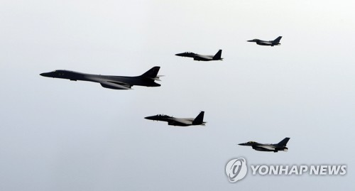 A B-1B Lancer, a strategic U.S. bomber, flies over Korea along with South Korean fighter jets in joint drills in this file photo provided by South Korea's Air Force. (Yonhap)