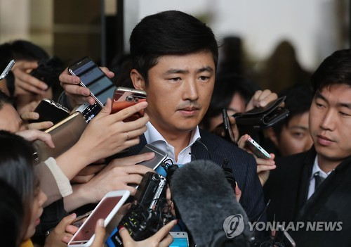 S. Korea prosecutors charge ousted leader Park and Lotte chief with bribery