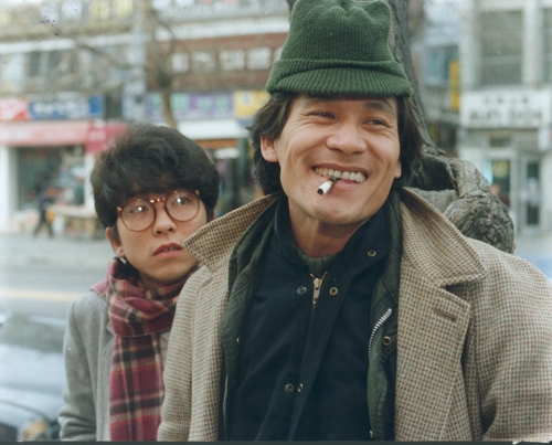 """This still photo provided by the Korea Film Archive shows actor Ahn Sung-ki (R) as Min-woo in """"Whale Hunting"""" (1984). (Yonhap)"""