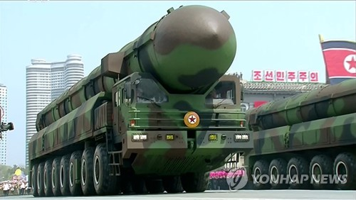 North Korea unveils what seems to be a new intercontinental ballistic missile (ICBM) at a military parade in Pyongyang on April 15, 2017 in a photo from North Korean TV footage. (Yonhap) [For Use Only in the Republic of Korea. No Redistribution]