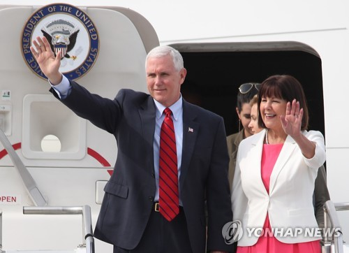 U.S. Vice President Mike Pence and his wife Karen Pence wave after landing at a U.S. air base in Pyeongtaek 70 kilometers south of Seoul