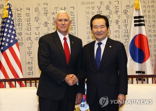 South Korea's National Assembly Speaker Chung Sye-kyun (R) shakes hands with U.S. Vice President Mike Pence before their talks at the Assembly in Seoul on April 17, 2017. (Pool photo) (Yonhap)