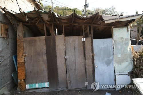 Guryong Village doesn't have a plumbing system. Its residents share makeshift toilets in wooden stalls shown in the photo taken on Nov. 3, 2016. (Yonhap)