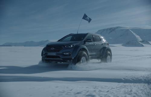 A Hyundai Santa Fe drives through the snow on journey to traverse the Antarctic in December. (Photo courtesy of Hyundai Motor)