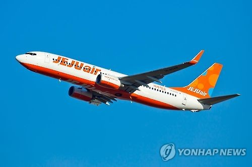 Jeju Air B737-800 jet taking off from an airport. (Yonhap)