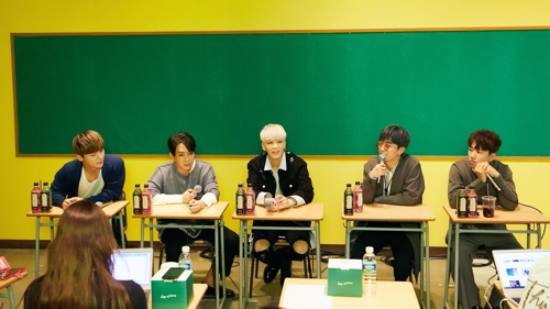 In this photo provided by YG Entertainment, members of South Korean idol group Sechs Kies speak to reporters during a group media interview on April 27, 2017, at a YG building in Seoul. (Yonhap)