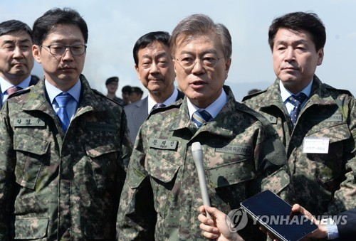 Moon Jae-in, elected South Korea's new president, speaks to reporters while clad in a military uniform during his visit to an Army firing test site in this file photo. (Yonhap)