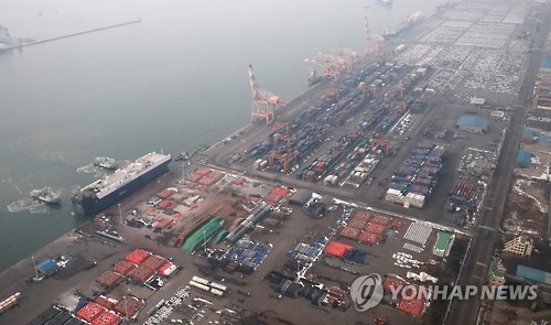 Containers and vehicles sit ready to be loaded onto ships at Pyeongtaek port in this undated file photo. (Yonhap)
