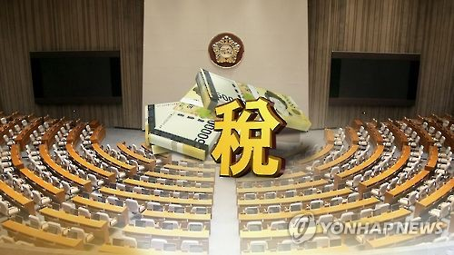 This undated Yonhap News TV captured image shows the Chinese character for taxes and an image of a pile of bank notes against the background of the National Assembly in Seoul. (Yonhap)