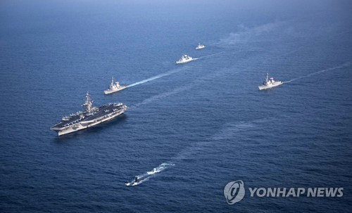 The U.S. Navy's Carl Vinson Strike Group holds a joint exercise with South Korean warships in the East Sea in this undated file photo provided by South Korea's Navy. (Yonhap)