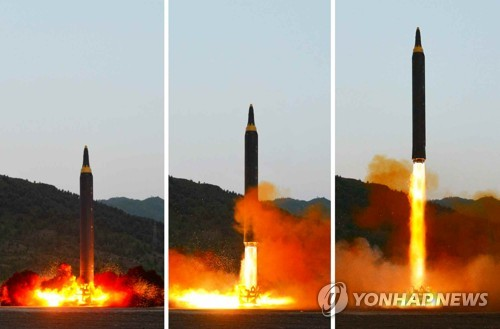 This set of photos carried by North Korea's main newspaper Rodong Sinmun on May 15, 2017, shows a new North Korean mid-to-long-range ballistic missile, called the Hwasong-12, which was launched a day earlier. (For Use Only in the Republic of Korea. No Redistribution) (Yonhap)