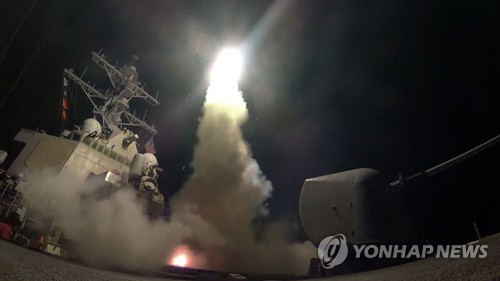 The USS Ross fires a tomahawk missile on April 7, 2017, from the Mediterranean Sea. The United States blasted a Syrian air base with a barrage of cruise missiles in retaliation for an alleged chemical weapons attack against civilians. (AP-Yonhap)