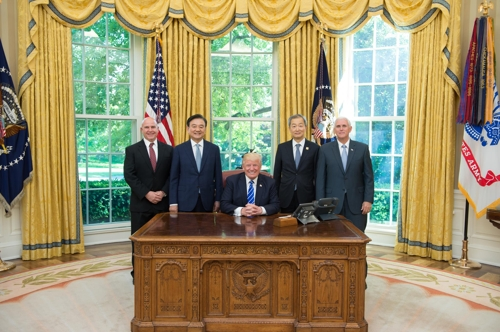 U.S. President Donald Trump poses for a photo with South Korea's presidential envoy Hong Seok-hyun, Vice President Mike Pence, National Security Advisor H.R. McMaster and South Korean Ambassador Ahn Ho-young during a meeting at the Oval Office on May 17, 2017. (Photo courtesy of the White House)