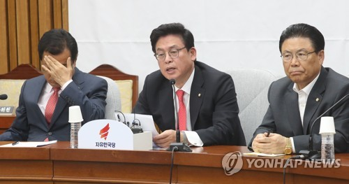 Korean officials meet in attempt to fix ties