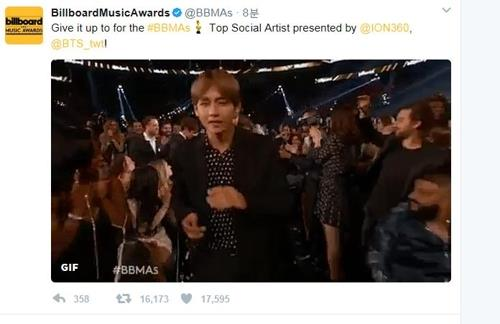 In this image taken from the Billboard Music Awards' Twitter page on May 22, 2017, BTS is called onto the stage to receive the Top Social Artist. (Yonhap)