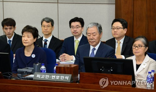 From president to prisoner 503: Park appears in court with her nemesis