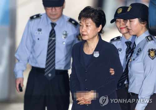 Former S.Korean president denies charges in court