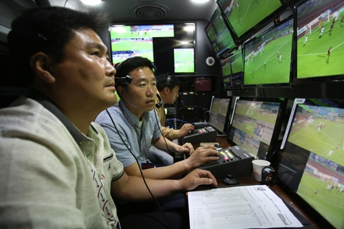 In this photo provided by the K League, video assistant referees watch video feeds in an operation room for their test operation of the video review system for the K League Classic match between Sangju Sangmu and Suwon Samsung Bluewings at Sangju Civic Stadium in Sangju, North Gyeongsang Province, on May 20, 2017. (Yonhap)