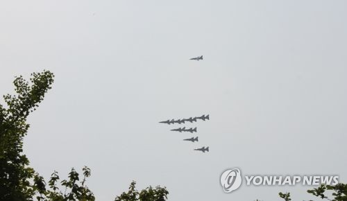 Korea fires warning shots at object flown from N. Korea